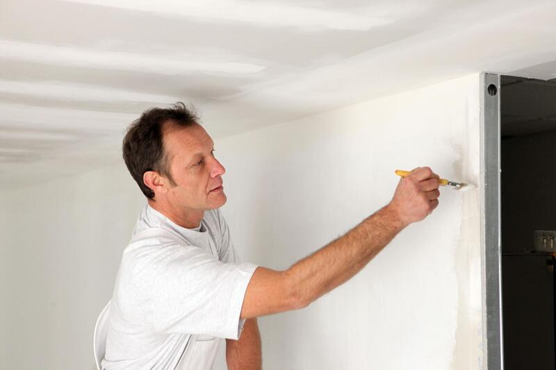 professional construction worker working on wall painting