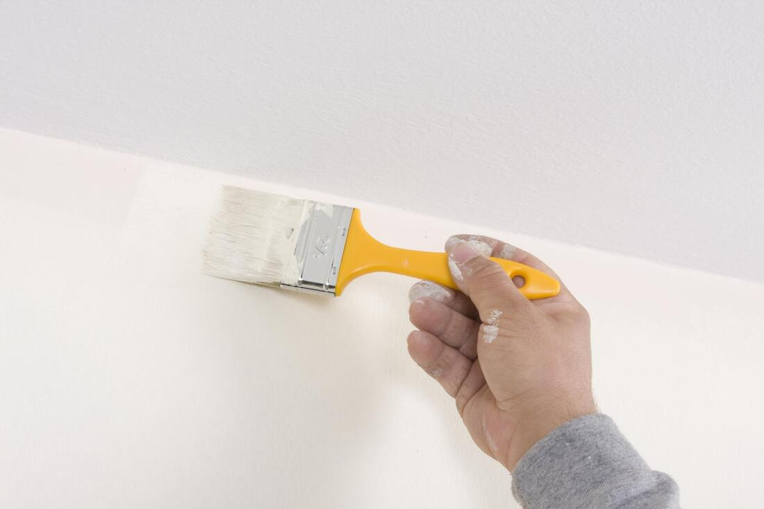 professional construction worker working on interior painting