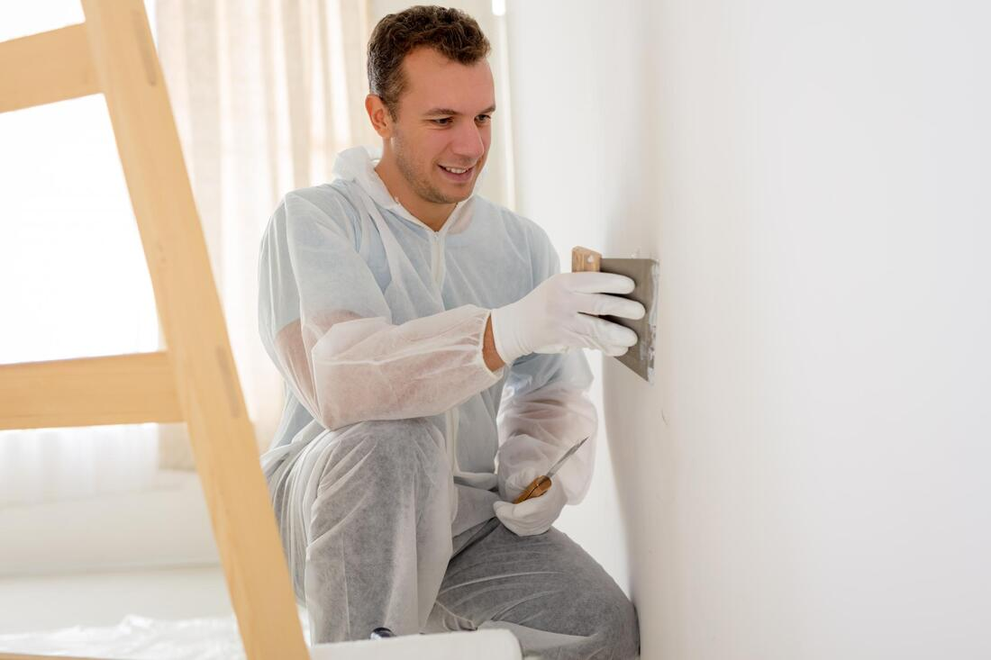 professional construction worker working on plaster repair