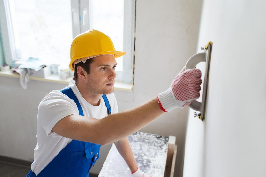 professional construction worker working on wall texture